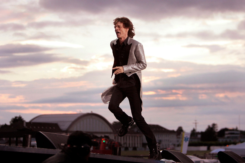 ". Rolling Stones vocalist Mick Jagger performs on stage during a concert at the military airport base in Duebendorf, Switzerland, as part of the band\'s ""A Bigger Bang\"" tour on Saturday, 5. August 2006. (KEYSTONE/Eddy Risch)"