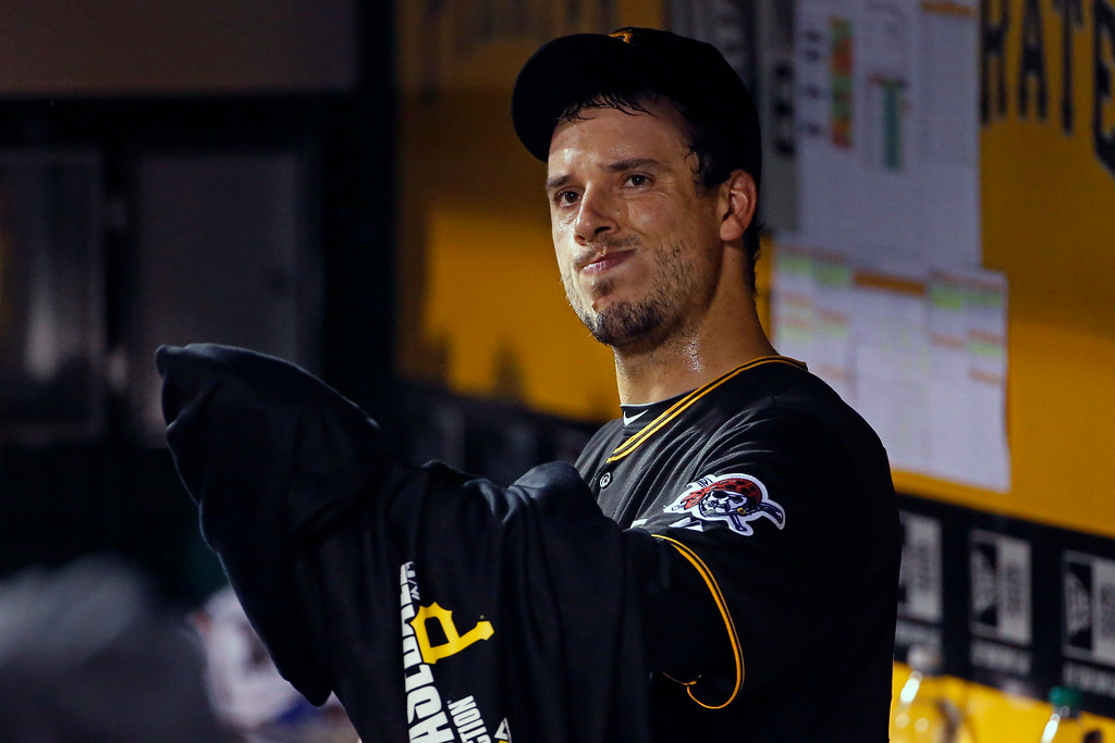 . Pittsburgh Pirates starting pitcher Charlie Morton puts on his jacket in the dugout after pitching the seventh inning of a baseball game against the Colorado Rockies in Pittsburgh Saturday, July 19, 2014. (AP Photo/Gene J. Puskar)