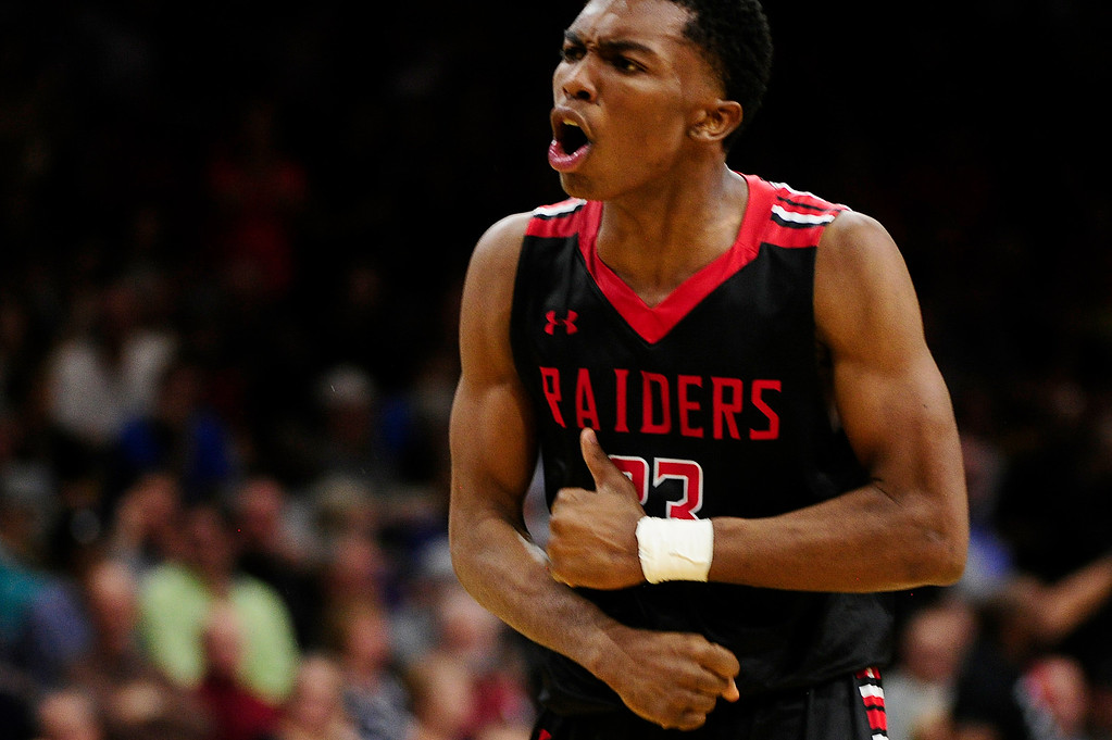 . Elijah Reed (23) of Rangeview celebrates getting fouled at the Coors Events Center on March 11, 2016 in Boulder, Colorado. Eaglecrest defeated Rangeview 58-55 to advance to the 5A finals of the Colorado state high school basketball tournament.  (Photo by Brent Lewis/The Denver Post)