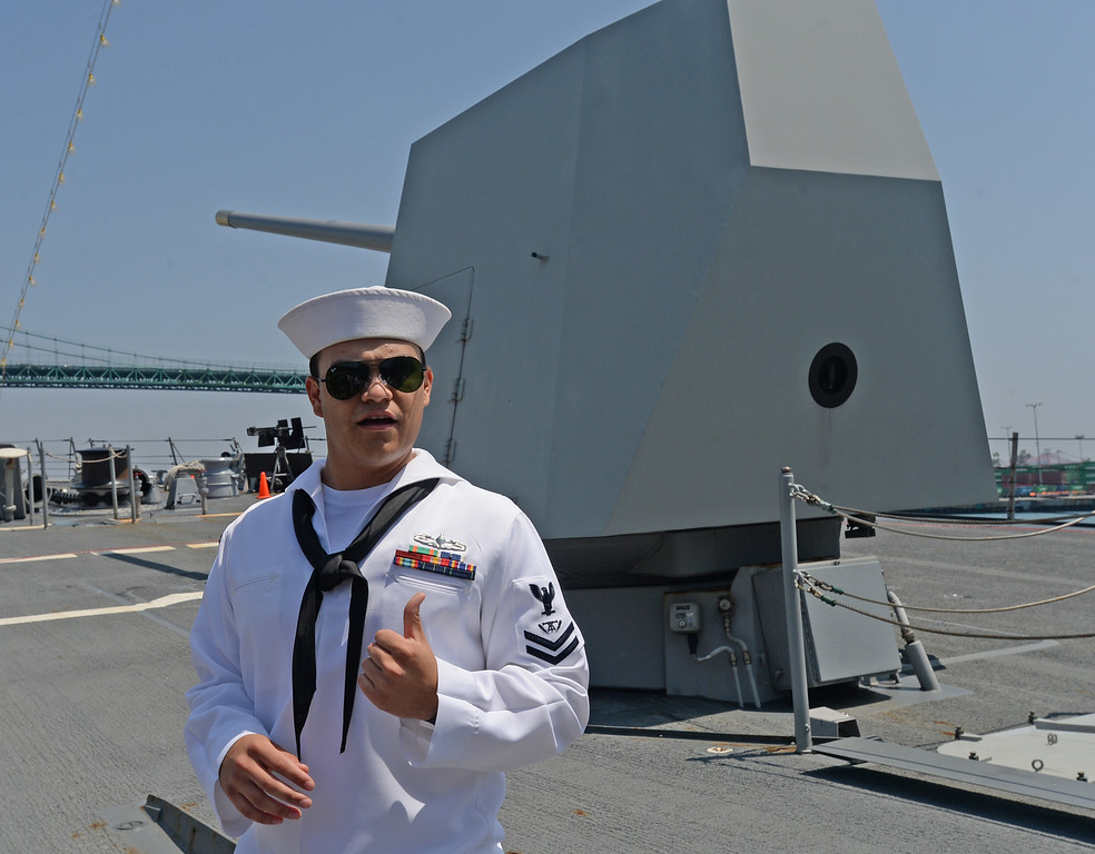 . People take a tour of the USS Spruance, an Arleigh Burke-class guided missile destroyer, which is docked in the Port of Los Angeles for Navy Days.  FC2 Joel Raygoza (SW) explains the gun system at the front of the ship. Saturday, August 09, 2014, San Pedro, CA.   Photo by Steve McCrank/Daily Breeze