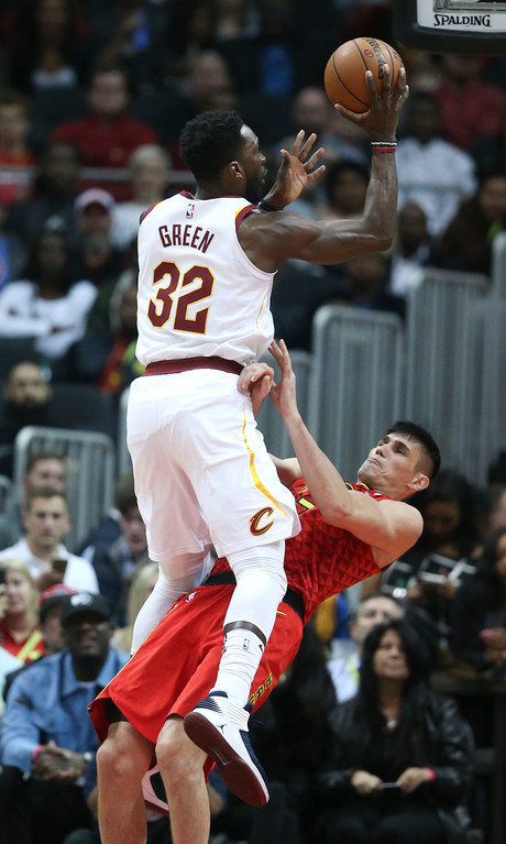 . Cleveland Cavaliers forward Jeff Green (32) fouls Atlanta Hawks forward Ersan Ilyasova (7) as he goes up for a shot in the first half of an NBA basketball game Thursday, Nov. 30, 2017, in Atlanta. Cleveland won 121-114. (AP Photo/John Bazemore)