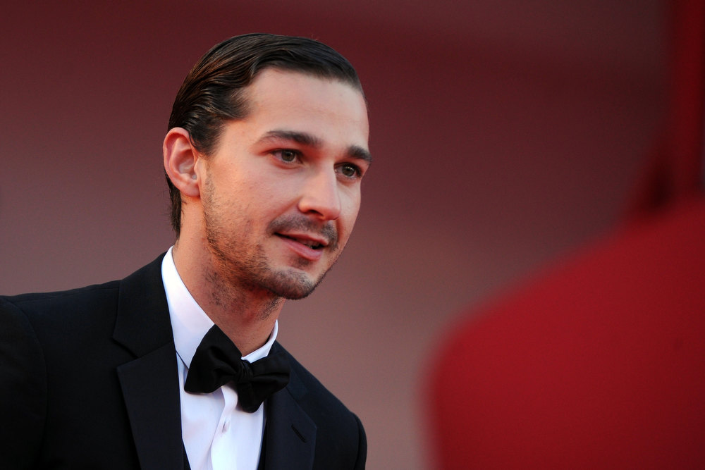 Description of . US actor Shia LaBeouf stands on the red carpet prior the screening of