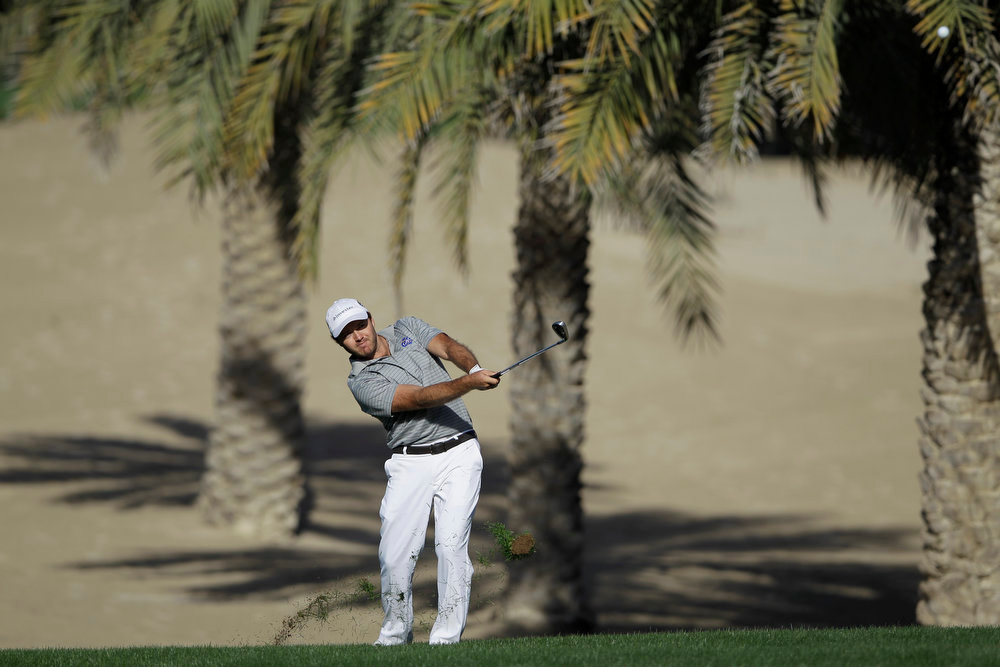 Description of . Richard Sterne from South Africa plays a ball on the 14th hole during the final round of the Dubai Desert Classic Golf tournament in Dubai, United Arab Emirates, Sunday, Feb. 3, 2013. (AP Photo/Kamran Jebreili)