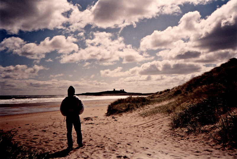 Hiking towards the ruins of Dunstanburgh Castle in the distance.