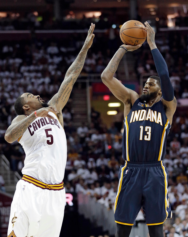 . Indiana Pacers\' Paul George (13) shoots over Cleveland Cavaliers\' J.R. Smith (5) in the second half in Game 1 of a first-round NBA basketball playoff series, Saturday, April 15, 2017, in Cleveland. The Cavaliers won 109-108. (AP Photo/Tony Dejak)