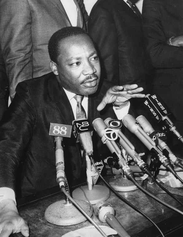 ". Dr. Martin Luther King Jr. is seen speaking to newsmen in Newark, N.J., on March 27, 1968. King is saying that he is ""disenchanted\"" with President Johnson\'s Vietnam policies and may endorse either Sen. Robert Kennedy or Sen. Eugene McCarthy for the Democratic Presidential nomination. (AP Photo)"