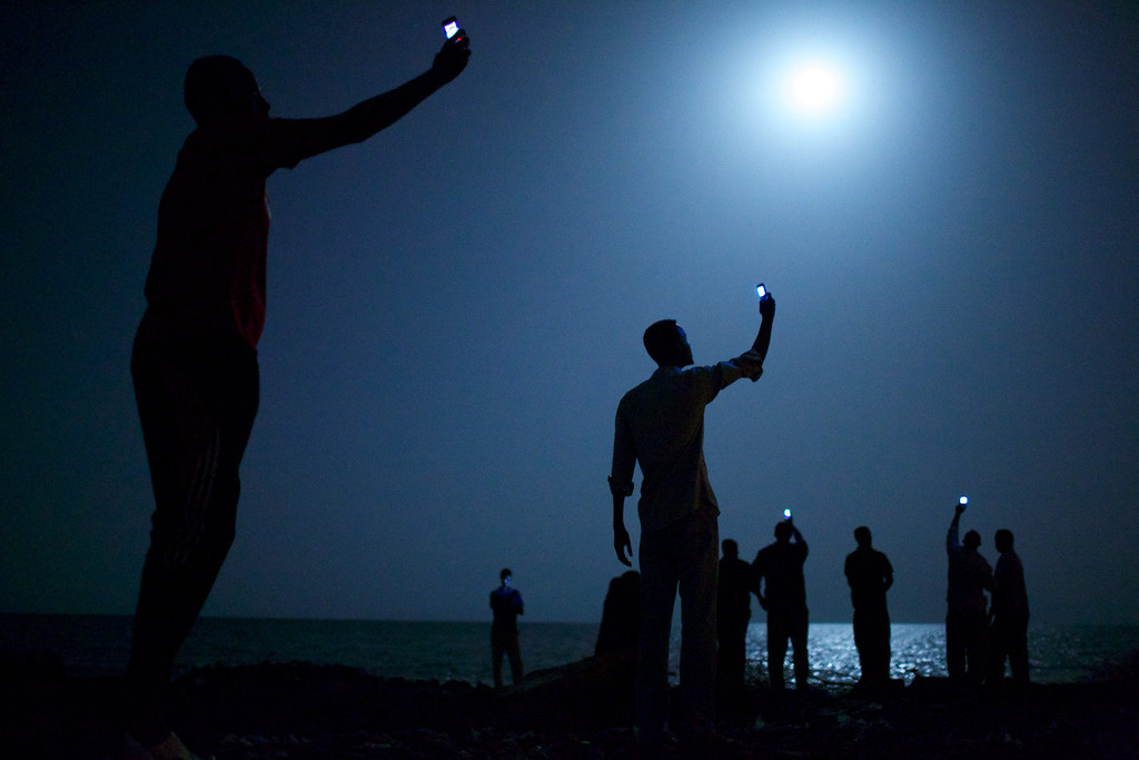 . This picture entittled \'Signal\' by US photographer John Stanmeyer of the VII Photo Agency is the World Press Photo of the Year 2013 in the 57th World Press Photo Contest, it was announced by the organizers on 14 February 2014 in Amsterdam, The Netherlands. The picture shows African migrants on the shore of Djibouti city at night, raising their phones in an attempt to capture an inexpensive signal from neighboring Somalia��îa tenuous link to relatives abroad. Djibouti is a common stop-off point for migrants in transit from such countries as Somalia, Ethiopia and Eritrea, seeking a better life in Europe and the Middle East. The picture also won 1st Prize in the Contemporary Issues category, and was shot for National Geographic.  EPA/JOHN STANMEYER / VII AGENCY/ NATIONAL GEOGRAPHIC