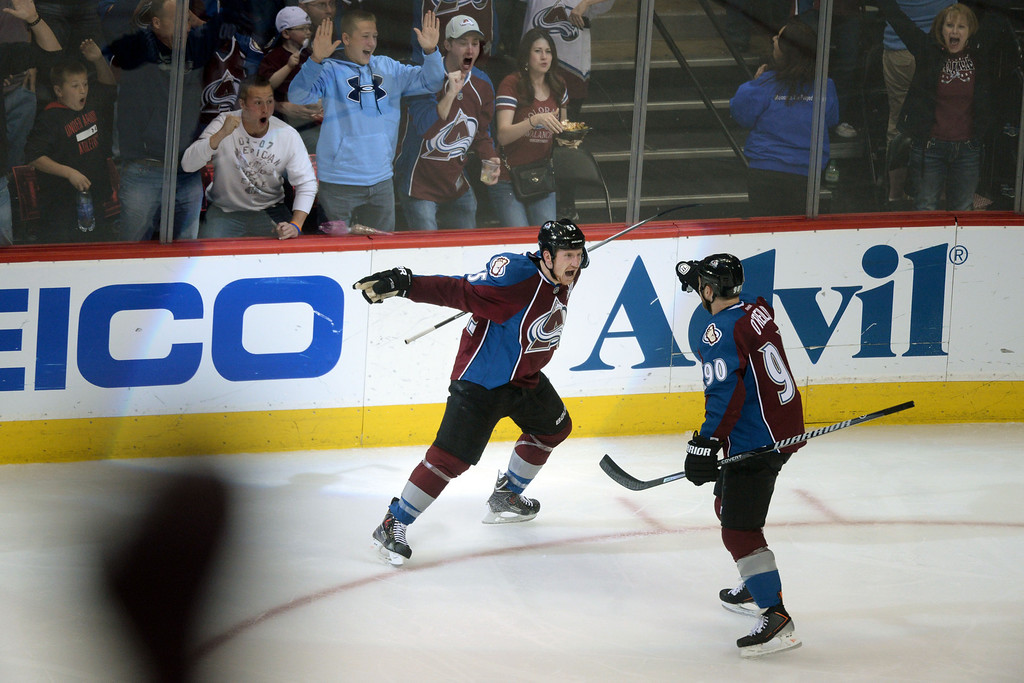 . DENVER, CO - APRIL 26: Cody McLeod (55) of the Colorado Avalanche celebrates with teammate Ryan O\'Reilly (90) after scoring a game-opening 1-0 goal against the Minnesota Wild during the second period. The Colorado Avalanche hosted the Minnesota Wild during game five of the first round of the NHL Stanley Cup Playoffs at the Pepsi Center on Saturday, April 26, 2014. (Photo by Karl Gehring/The Denver Post)