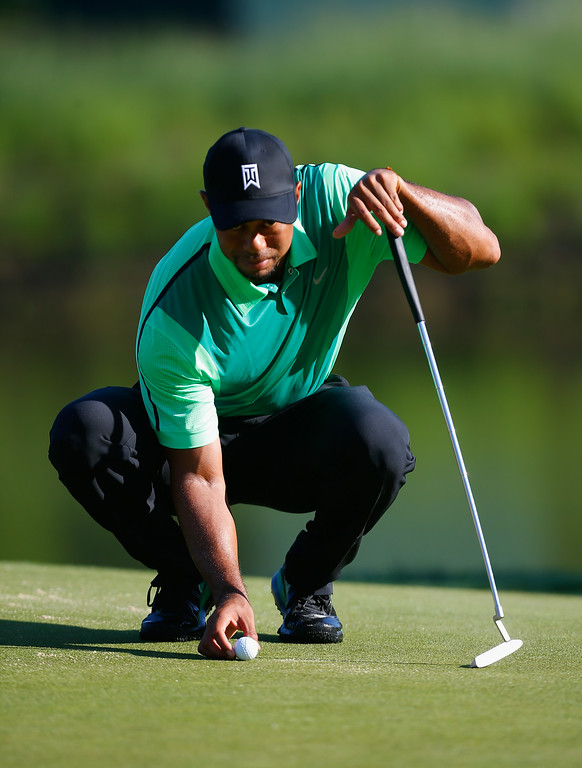 . BETHESDA, MD - JUNE 26:  Tiger Woods of the United States studies his putt on the tenth hole during a first round of the Quicken Loans National at Congressional Country Club on June 26, 2014 in Bethesda, Maryland.  (Photo by Jeff Haynes/Getty Images)