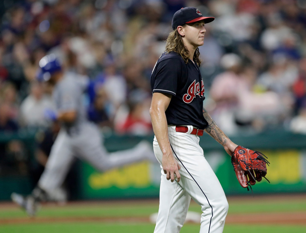 . Cleveland Indians starting pitcher Mike Clevinger waits for Kansas City Royals\' Alex Gordon to run the bases after Gordon hit a solo home run in the fourth inning of a baseball game, Tuesday, Sept. 4, 2018, in Cleveland. (AP Photo/Tony Dejak)