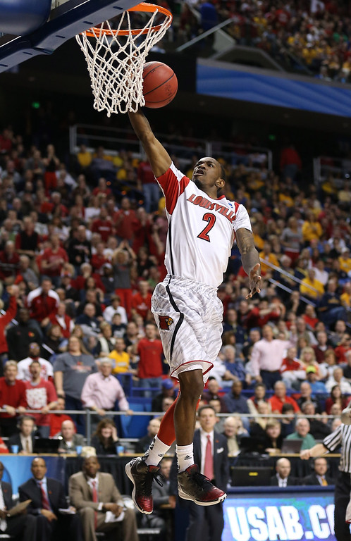 . LEXINGTON, KY - MARCH 23: Russ Smith #2 of the Louisville Cardinals drives to the basket against the Colorado State Rams during the third round of the 2013 NCAA Men\'s Basketball Tournament at Rupp Arena on March 23, 2013 in Lexington, Kentucky.  (Photo by Andy Lyons/Getty Images)