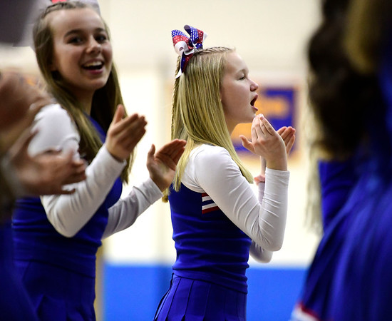 3/8/2019 Mike Orazzi   Staff St. Paul Catholic High School cheerleaders during the Class S Semifinal girls basketball game with Trinity Catholic at Newtown High School Friday night in Newtown.