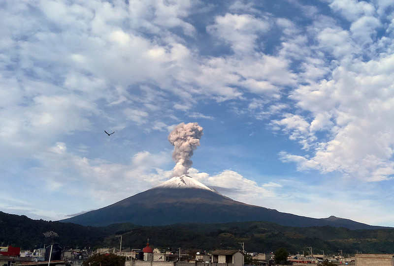 . In this Saturday, Sept. 27, 2014 photo, a plume of steam, gas and ash rises from the crater of the Popocatepetl volcano as seen from the town of San Nicolas de los Ranchos, Mexico. According to Mexico\'s National Disaster Prevention center (CENAPRED) the exhalation, recorded at 08:41 am local time, reached a height of 1500 meters and was later carried by the winds in a southwesterly direction. (AP Photo/Dario Lopez-Mills)