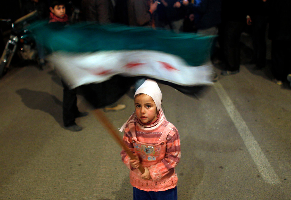 . A girl waves a Syrian opposition flag during a protest against Syrian President Bashar al Assad in Al Qusayr February 27, 2012.  REUTERS/Goran Tomasevic