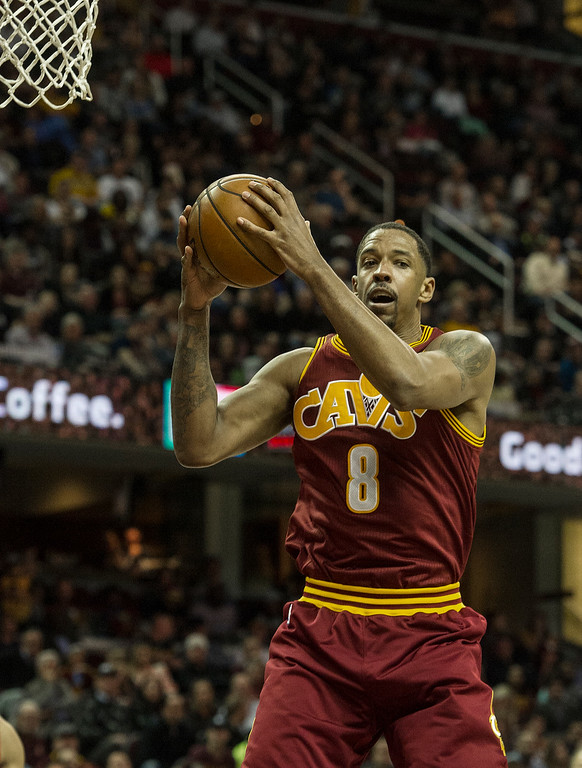 . Cleveland Cavaliers\' Channing Frye (8) grabs a rebound during the second half of an NBA basketball game against the Toronto Raptors in Cleveland, Tuesday, Nov. 15, 2016. The Cavaliers won 121-117. (AP Photo/Phil Long)