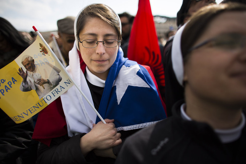 . A nun prays holding a flagg pictured a photograph of Pope Benedict XVI on February 24, 2013 in Vatican City, Vatican. Pope Benedict XVI delivers his last Angelus Blessing from the window of his private apartment to thousands of pilgrims gathered in Saint Peter\'s Square on February 24, 2013 in Vatican City, Vatican. The Pontiff will hold his last weekly public audience on February 27, 2013 before he retires the following day. Pope Benedict XVI has been the leader of the Catholic Church for eight years and is the first Pope to retire since 1415. He cites ailing health as his reason for retirement and will spend the rest of his life in solitude away from public engagements.  (Photo by Carsten Koall/Getty Images)