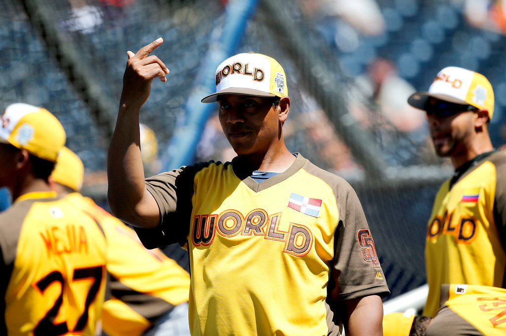 . World Team\'s hitting coach Luis Ortiz gestures to his players prior to the All-Star Futures baseball game against the U.S. Team, Sunday, July 10, 2016, in San Diego. (AP Photo/Lenny Ignelzi)