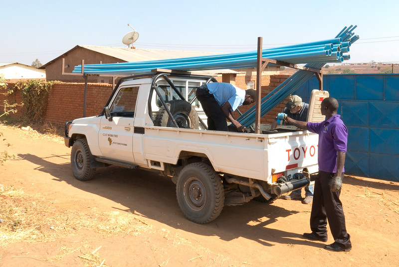 Trusty Toyota trucks are used to haul piping, pumps, and volunteers to rural villages, some quite remote.