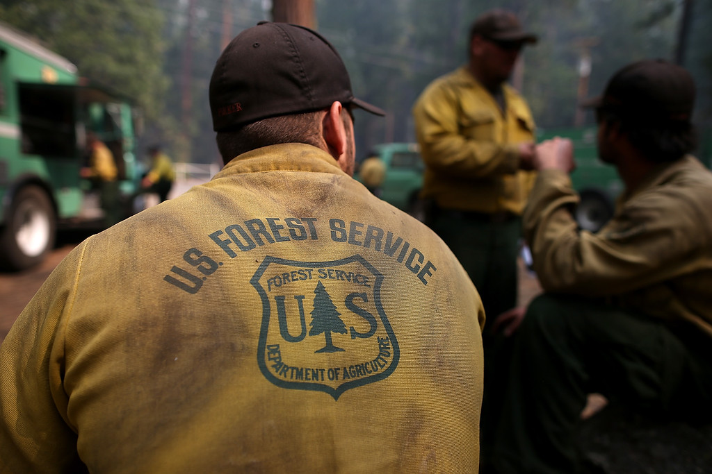 . Forest Service firefighters take a break from battling the Rim Fire at Camp Mather on August 25, 2013 near Groveland, California.  (Photo by Justin Sullivan/Getty Images)