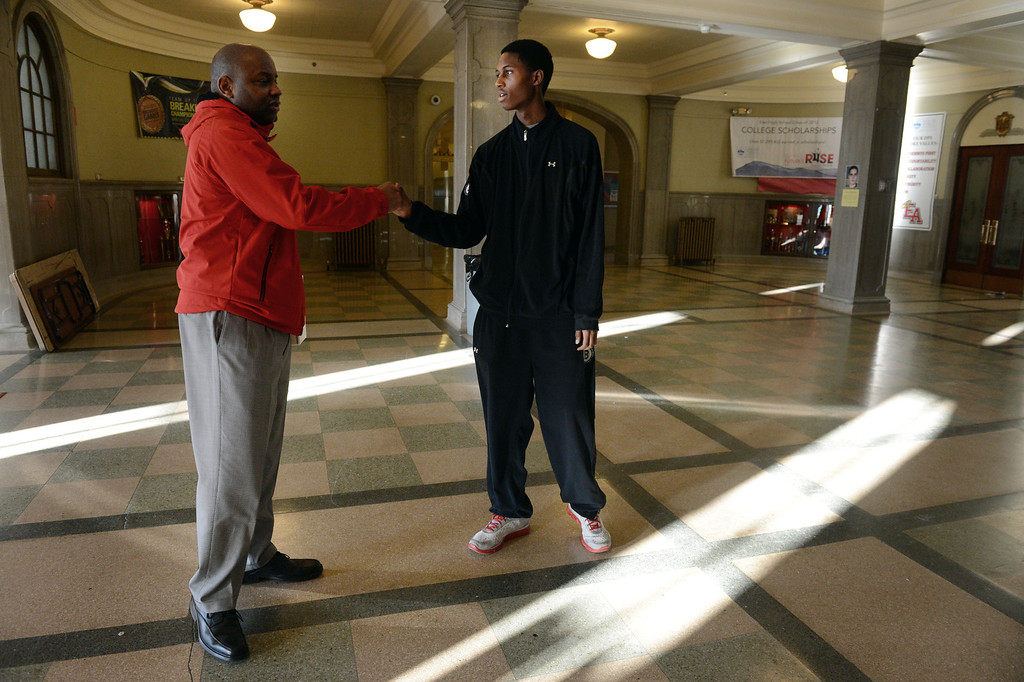 . DENVER, CO. - FEBRUARY 12: Senior Jaycee Floyd talks with Ronald Sally, left, of Project Greer Street following a meeting at East High School in Denver, CO February  07, 2013. The academic program promotes achievement among male African-American high school students. (Photo By Craig F. Walker/The Denver Post)