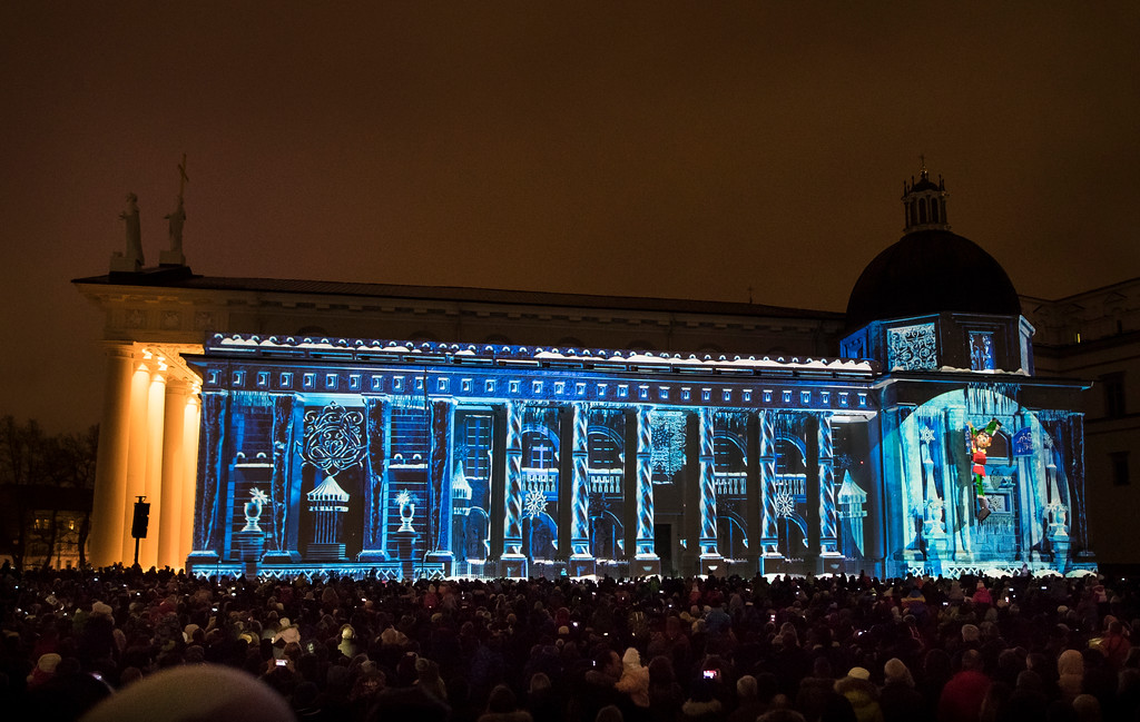 . A large crowd watch a light show projected onto the Cathedral-Basilical during the Christmas celebration at Cathedral square in Vilnius, Lithuania, Monday, Dec. 25, 2017. Over 80 percent of Lithuanians are Christians who celebrate the festival of Christmas on Dec. 25. (AP Photo/Mindaugas Kulbis)