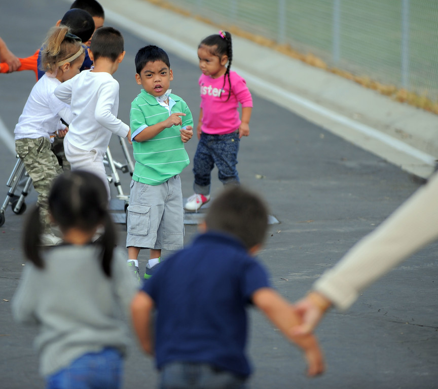 . Students head to recess at Buffum Total Learning Center in Long Beach, CA on Wednesday, October 9, 2013.  Beginning next week, Buffum, a pre-school for special needs students, will start a program called Typical Peers which will have their students with disabilities working side by side with normally developing students. (Photo by Scott Varley, Daily Breeze)