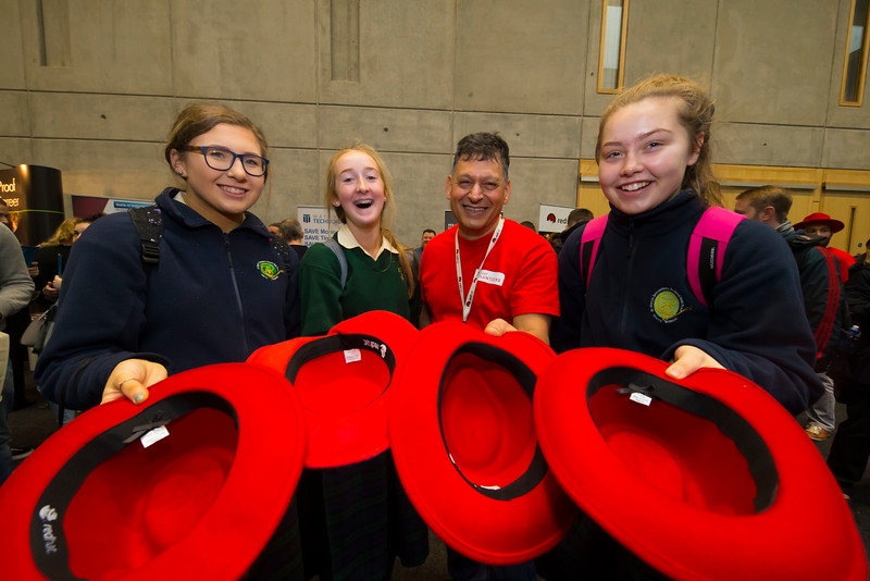 """09/11/2017. Crystal Valley Tech Showcase at WIT Arena. Pictured is Luigi Zucarelli of Red Hat with Grainne Flannery, Aisling Murphy and Hannah Dunphy from St Mary's Secondary School, New Ross Co. Wexford. Picture: Patrick Browne   Event demonstrates Tech and ICT is thriving in Wexford and the South East 50 companies and 2,000 students, industry and recruiters attend the inaugural Crystal Valley Tech Showcase event  Over 50 companies who are working together as Crystal Valley Tech showcased their rapidly growing industry in the WIT Arena on Thursday morning to approx. 2,000 members of the public, college and second level students, recruiters, government agencies and other industry.  The future is bright for ICT in the South East according to Dr Padraig Kirwan, Head of the Department of Computing & Mathematics at Waterford Institute of Technology. """"Computing is thriving in the South East judging by the number and diversity of ICT companies here today. Even more encouraging is the number of second level students who attended from Waterford, Kilkenny, Carlow, Tipperary and Wexford and how interested they are about the career opportunities in this exciting industry.""""  Wexford schools attending the event included St. Mary's CBS in Enniscorthy, St Mary's Secondary School in New Ross and Colaiste an Atha in Kilmuckridge.  Elaine Fennelly, Bluefin Payment Systems General Manager and co-founder of Crystal Valley Tech is very excited about the industry in the South East and today's showcase event. """"People who work in the industry already know that Tech is well established in the South East and the number of opportunities and companies continues to grow and grow. According to a recent Tech Ireland report there are over 60 indigenous and multinational companies employing well over 1,500 people from their bases in Waterford, Wexford, Kilkenny and Carlow.  """"However, we weren't so sure that people in the region realised just how big the ICT industry is becoming and"""