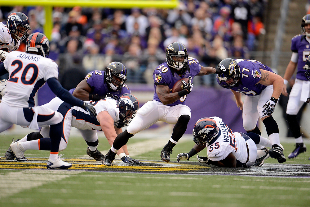 Description of . Baltimore Ravens running back Bernard Pierce (30) picks up a big gain agains the Denver Broncos defense in the second quarter Sunday, December 16, 2012 at M&T Bank Stadium. John Leyba, The Denver Post