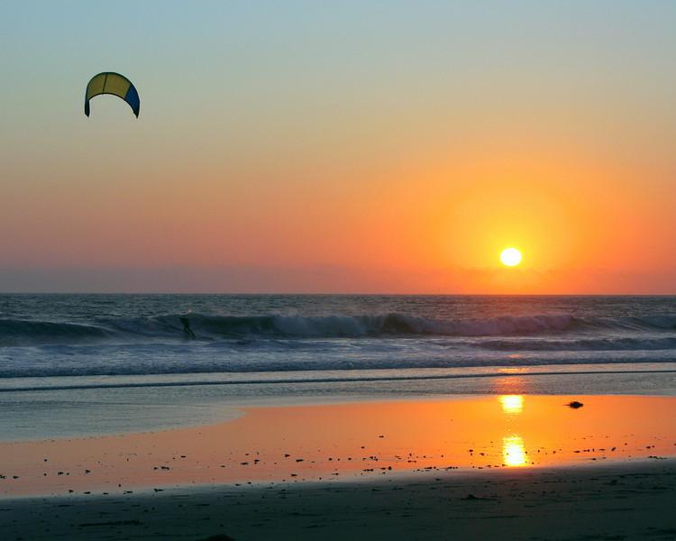 Sunset and kite surfer on the San Mateo coast.