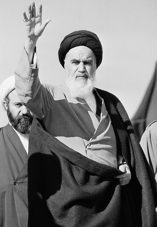 . 1979: Ayatollah Khomeini. Ayatollah Khomeini waves to his followers in Qom, Iran, Dec. 17, 1979. The Iranian leader has not yet commented on the Shah\'s move to Panama.  (AP Photo/Jacques Langevin)