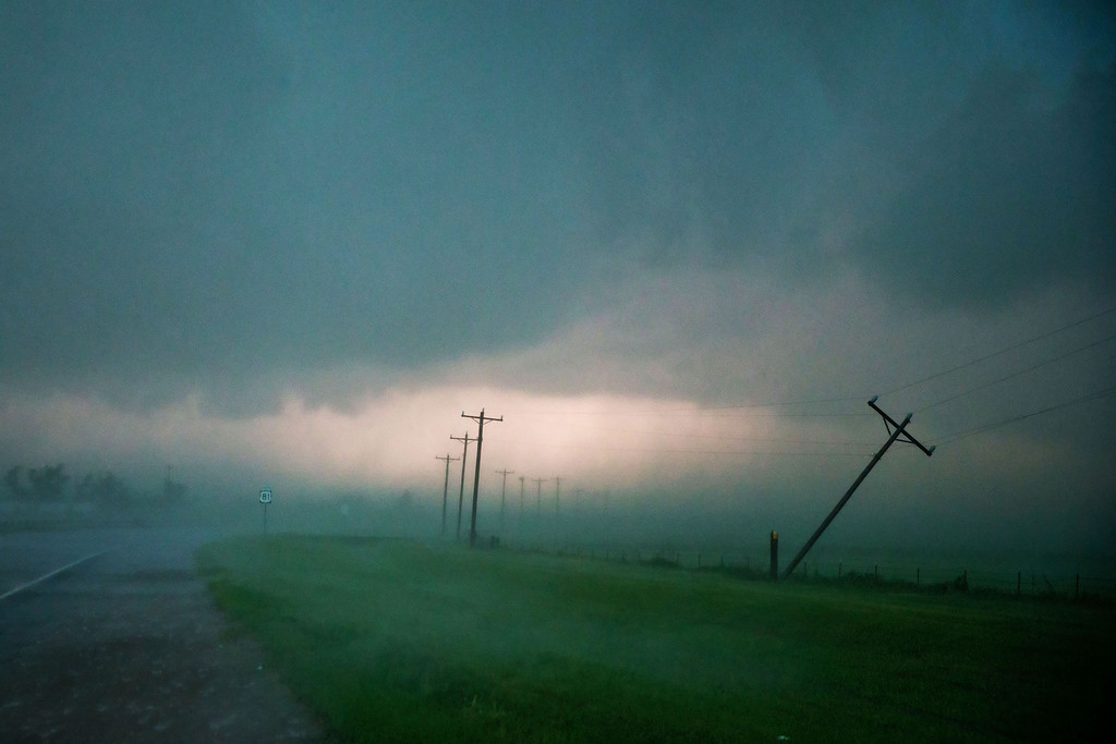 . High winds snapped this power pole on from Highway 81 just south El Reno Okla. on Friday May 31, 2013. Tornadoes rolled in from the prairie and slammed Oklahoma City and its suburbs on Friday, killing a mother and baby and crumbling cars and tractor-trailers along a major interstate. (AP Photo/The World-Herald, Chris Machian)