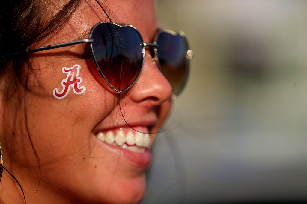 . MIAMI GARDENS, FL - JANUARY 07:  An Alabama fan smiles before the 2013 Discover BCS National Championship game between the Alabama Crimson Tide and the Notre Dame Fighting Irish at Sun Life Stadium on January 7, 2013 in Miami Gardens, Florida.  (Photo by Mike Ehrmann/Getty Images)