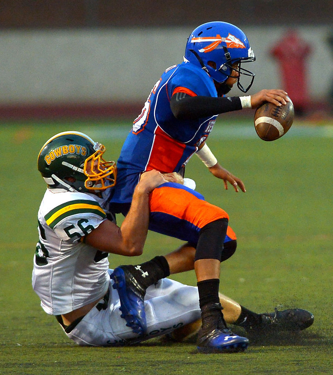. Westlake High quarterback Malik Henry is sacked by Ronnie Walker of Canyon High August 30, 2013 in Westlake Village, CA.(Andy Holzman/Los Angeles Daily News)