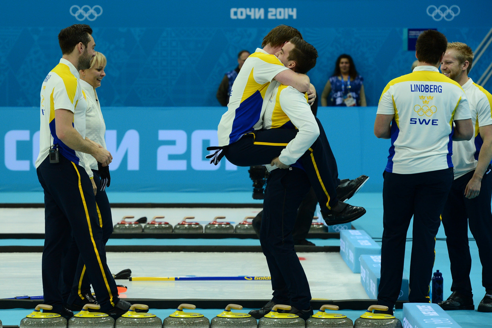 . Sweden\'s Fredrik Lindberg (R) and teammates celebrate after winning the men\'s Bronze medal match between Sweden and China at the Ice Cube curling centre in Sochi on February 21, 2014 during the 2014 Sochi winter Olympics.  JOHN MACDOUGALL/AFP/Getty Images