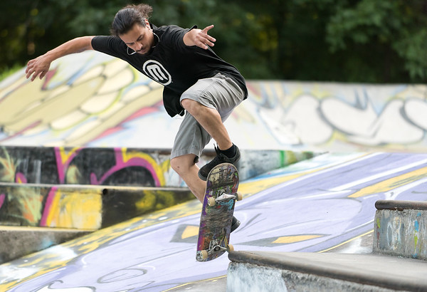 08/09/18 Wesley Bunnell | Staff Carlos Ramos of Newington performs a K-Grind at Stanley Quarter Park on Thursday afternoon.