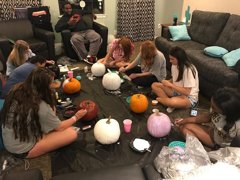 Jessica Gordon, Ana Gutierrez, Sam Kane, Russell Hughes, Sydney Huggins, Katie Wilkerson, Kaylee Henning, and A'leicia Simpson paint pumpkins to get in the fall spirit.
