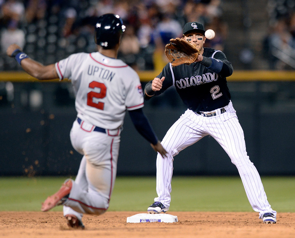 . Colorado shortstop Troy Tulowitzki made a force out on Atlanta baserunner B.J. Upton at second base in the sixth inning. Unfortunately Tulo ran out of time to throw to first sand there was no double play. The Colorado Rockies hosted the Atlanta Braves Tuesday night, June 10, 2014. (Photo by Karl Gehring/The Denver Post)