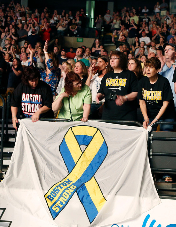 . Concert goers hold a banner as they watch the Boston Strong Concert: An Evening of Support and Celebration at the TD Garden on Thursday, May 30, 2013 in Boston. (Photo by Bizuayehu Tesfaye/Invision/AP)