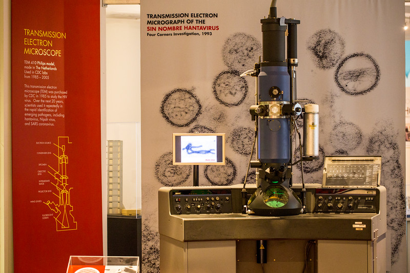 One of several perminate exhibits at the David J. Sencer CDC Museum is an installion about the Transmission Electron Microscope, initially  purchased in 1985 to study the HIV virus.  The operational microscopes at the CDC are even larger than this technology phased out in 2005.  The museum highlights information and history of AIDS, Smallpox, Legionnaires' Disease, Venereal Disease, Ebola and much more.  (Jenni Girtman / Atlanta Event Photography)