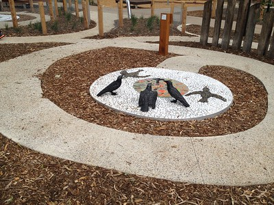 crow sculptures with inlaid pebble artwork maze