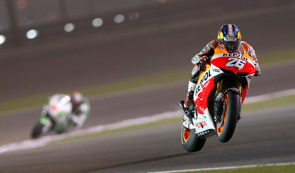 . Honda MotoGP rider Dani Pedrosa of Spain rides his bike during a free practice session at the MotoGP World Championship at the Losail International circuit in Doha April 5, 2013. REUTERS/Fadi Al-Assaad