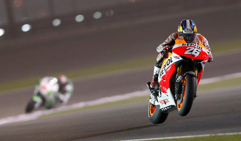 . Honda MotoGP rider Dani Pedrosa of Spain rides his bike during a free practice session at the MotoGP World Championship at the Losail International circuit in Doha April 5, 2013. REUTERS/Fadi Al-Assaad