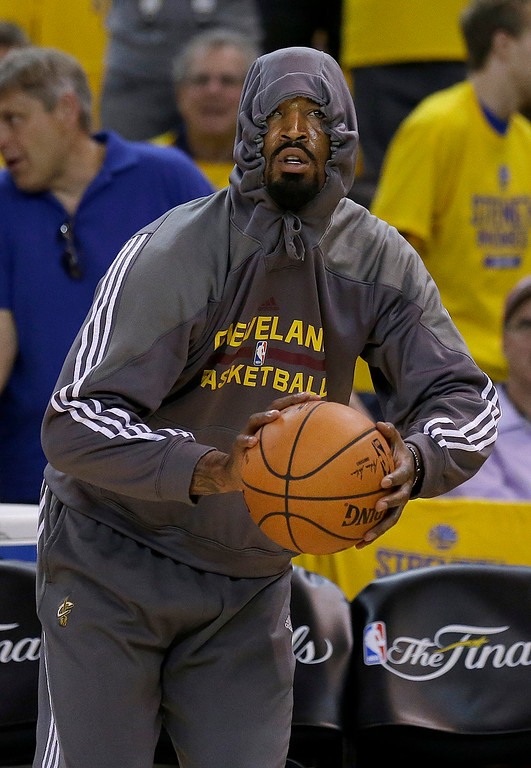 . Cleveland Cavaliers guard J.R. Smith warms up before Game 1 of basketball\'s NBA Finals against the Golden State Warriors in Oakland, Calif., Thursday, June 4, 2015. (AP Photo/Ben Margot)