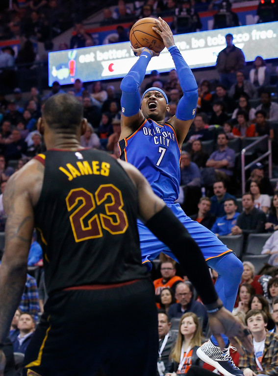 . Oklahoma City Thunder forward Carmelo Anthony (7) shoots over Cleveland Cavaliers forward LeBron James (23) during the second half of an NBA basketball game in Oklahoma City, Tuesday, Feb. 13, 2018. (AP Photo/Sue Ogrocki)