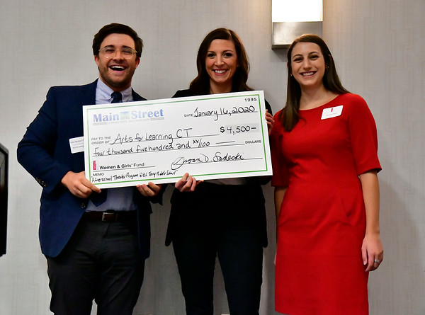 1/16/2020 Mike Orazzi | StaffnArts for Learning CT's John Michael Parker accepts a check from Julia Weston and Jessica Pieri during The Women and Girls Fund of the Main Street Community Foundation grant reception at the DoubleTree Hotel in Bristol on Thursday night.
