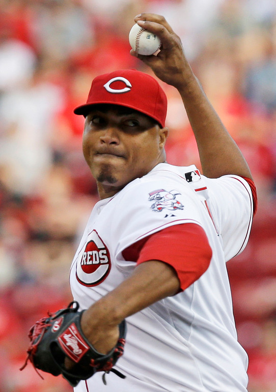 . Cincinnati Reds starting pitcher Alfredo Simon throws against the Colorado Rockies in the first inning of a baseball game on Saturday, May 10, 2014, in Cincinnati. (AP Photo/Al Behrman)