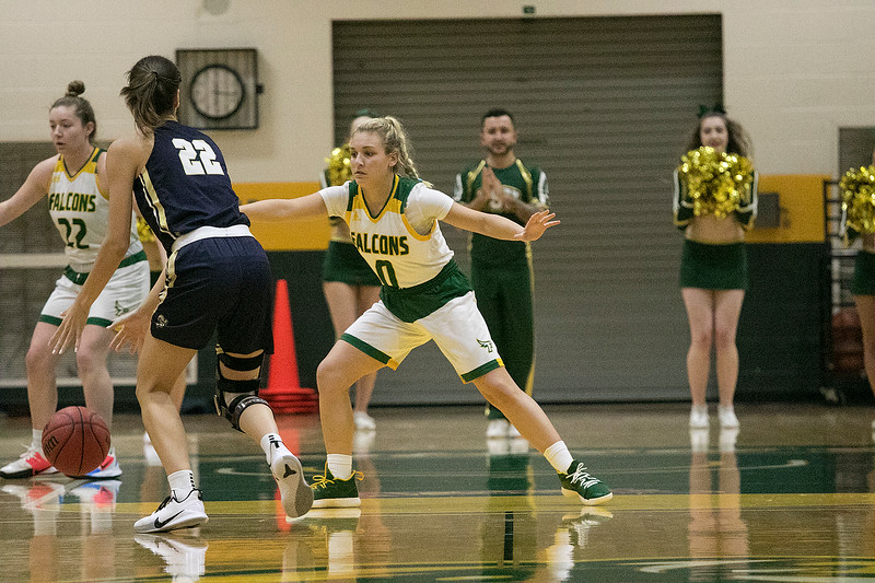 Fitchburg State University women's basketball played Suffolk University on Wednesday night, Dec. 4, 2019. FSU's #0 Angelina Marazzi covers SU's #22 Alexis Hackett during action in the game. SENTINEL & ENTERPRISE/JOHN LOVE