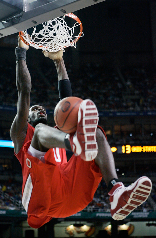 . Ohio State center Greg Oden (20) stuff\'s the ball against Florida in the first half during their men\'s championship basketball game at the Final Four in the Georgia Dome in Atlanta Monday, April 2, 2007. (AP Photo/Gerry Broome)