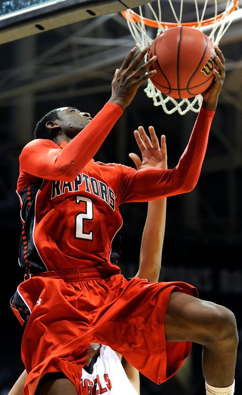 . BOULDER, CO. - MARCH 16: Raptors senior guard TreShawn Wilford (2) cruised under the basket in the second half. The Eaglecrest High School boy\'s basketball beat Denver East 63-44 in the 5A championship game Saturday, March 16, 2013 at the Coors Events Center in Boulder.  (Photo By Karl Gehring/The Denver Post)