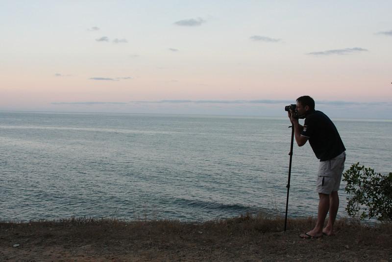 Sunset along the highway between Cairns and  Mossman. Craig taking photos.